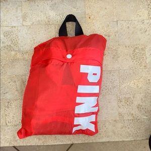 Pink packable duffel